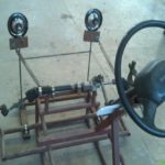 front-wheel-steering-system-with-movable-headlight